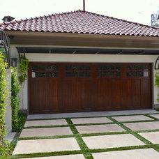 Mediterranean Garage And Shed by Kitchens Baths & Closets, LLC