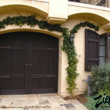 Mediterranean Garage And Shed by Ziegler Doors Inc.