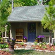 Traditional Garage And Shed by Kingdom Landscape