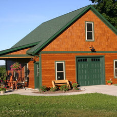 Traditional Garage And Shed by JG Development, Inc.