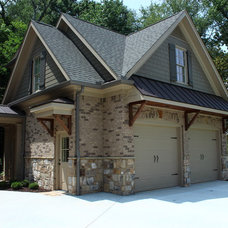 Traditional Garage And Shed by Paragon Construction Services