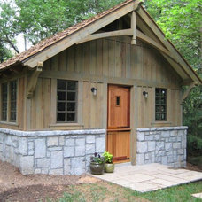 Traditional Garage And Shed by Home Rebuilders