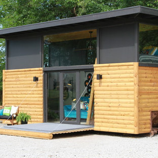 Small trendy detached shed photo in Other