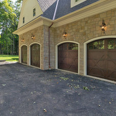Traditional Garage And Shed by L&L Builders Corp