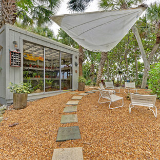 Island style shed photo in Tampa