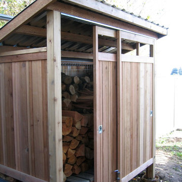 Firewood shed built with reclaimed materials.