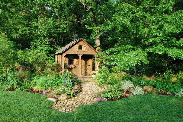 Rustic Garage And Shed by Landscapes by Dallas Foster, Inc