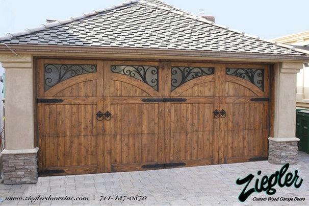 Mediterranean Garage And Shed by Ziegler Doors Inc.