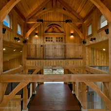 Traditional Garage And Shed by Three Elements Timberworks Inc.