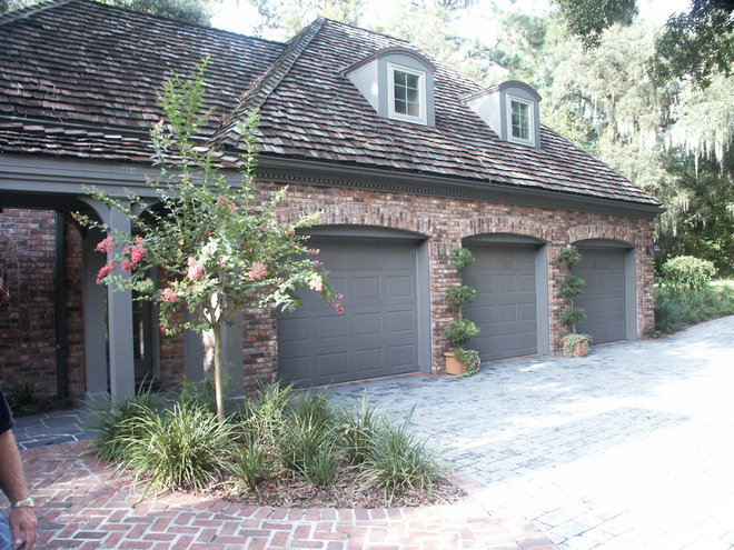 Traditional Garage And Shed by Aspen Diversified Construction, Inc.