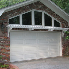 Traditional Garage And Shed by Arbororiginal
