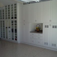 Traditional Garage And Shed by American Organizers Custom Closet & Cabinets