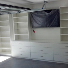 Contemporary Garage And Shed by Dream's Closets