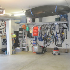 Traditional Garage And Shed by Garage Remedy