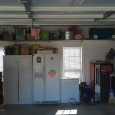 Traditional Garage And Shed by The Garage Authority