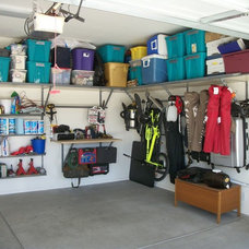 Traditional Garage And Shed by The Garage Center LLC