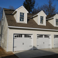 Traditional Garage And Shed by Taitco & Tait Roofing, Inc