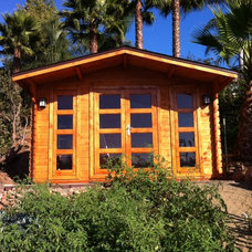 Traditional Garage And Shed by SolidBuild Inc.