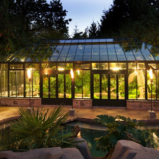 Photo of a large modern detached greenhouse in Vancouver.