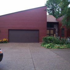 Modern Garage And Shed by Ultimate Exteriors of Minnesota