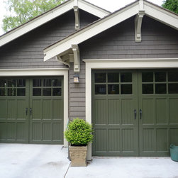 Heritage Garage Door - 3 Piece Heritage Wood with True Divided LIte Top Section and Large Centre Style.  Installed by Harbour Door, Victoria, BC