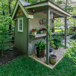 Photo of a mid-sized country detached garden shed in Charlotte.