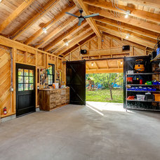 Rustic Garage And Shed by King Building & Remodeling LLC