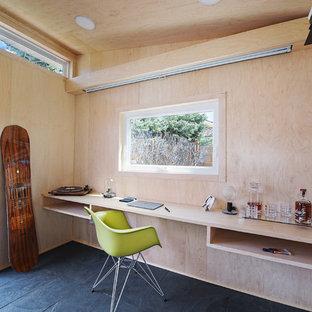 Inspiration for a small contemporary detached studio / workshop shed remodel in Denver