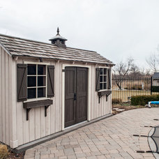 Traditional Garage And Shed by Tucker Construction Ltd.