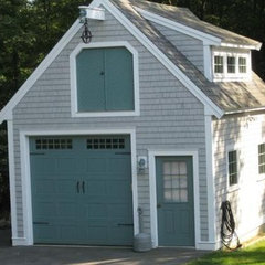 traditional garage and shed House with cool different sizing of windows