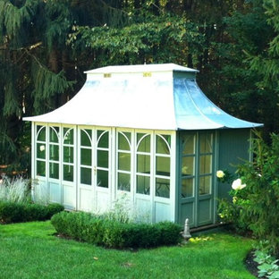 Inspiration for a medium sized classic detached garden shed in Minneapolis.