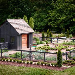 Foto di un capanno da giardino o per gli attrezzi indipendente chic