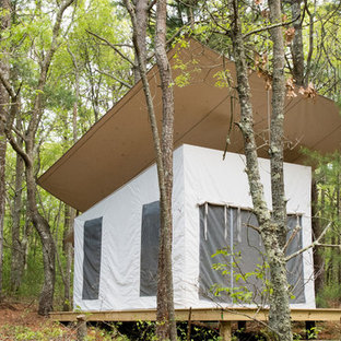 Example of a mountain style detached guesthouse design in Boston