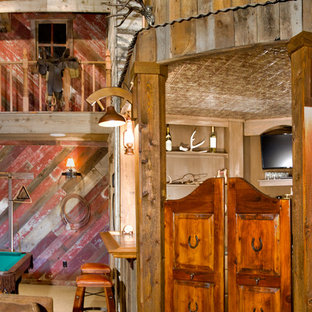 This is an example of a medium sized rustic barn in Denver.