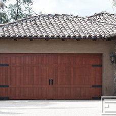 Mediterranean Garage And Shed by Dynamic Garage Door