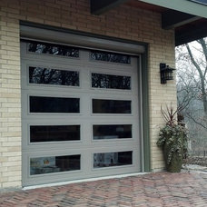 Contemporary Garage And Shed by Retractable Screens, LLC