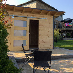 Photo of a small transitional detached studio in Toronto.