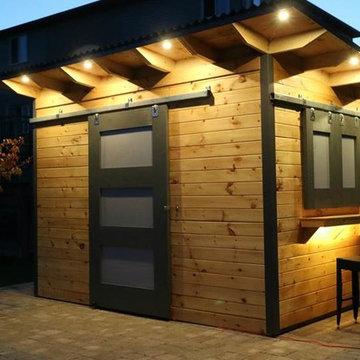Modern Bar Shed with Sliding Barn door an siding Windows