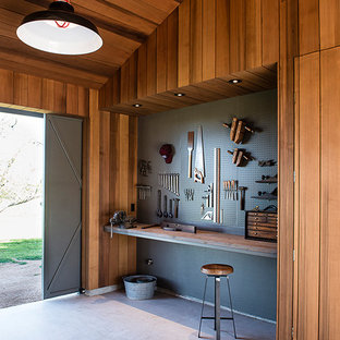 Photo of a medium sized farmhouse attached office/studio/workshop in Austin.