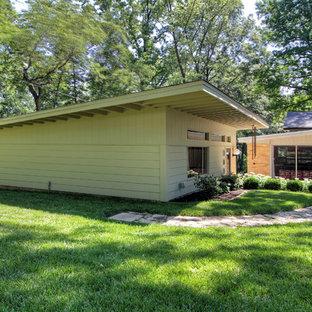 Garden shed - large modern detached garden shed idea in St Louis