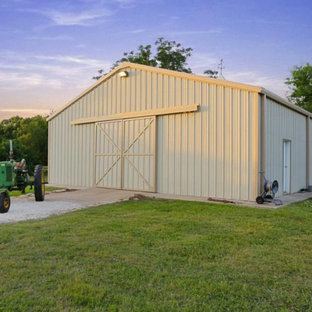 This is an example of an expansive country detached barn in Houston.