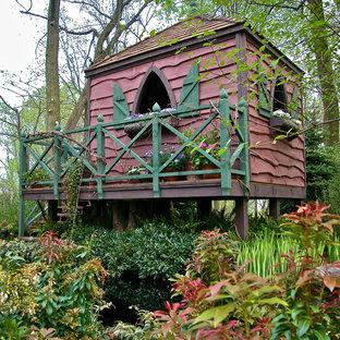 Idéer för ett eklektiskt fristående trädgårdsskjul