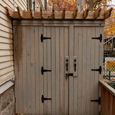 Traditional Garage And Shed by Tiger Lily Landscapes, LLC