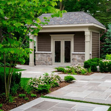 Traditional Garage And Shed by Uncommon Ground Landscape Design