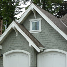 Traditional Garage And Shed by StormX Construction