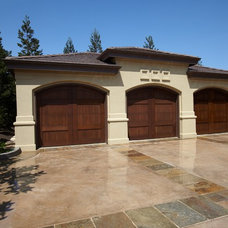 Mediterranean Garage And Shed by NORMAN CHARLES CONSTRUCTION