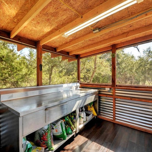 Mid-sized mountain style shed photo in Austin