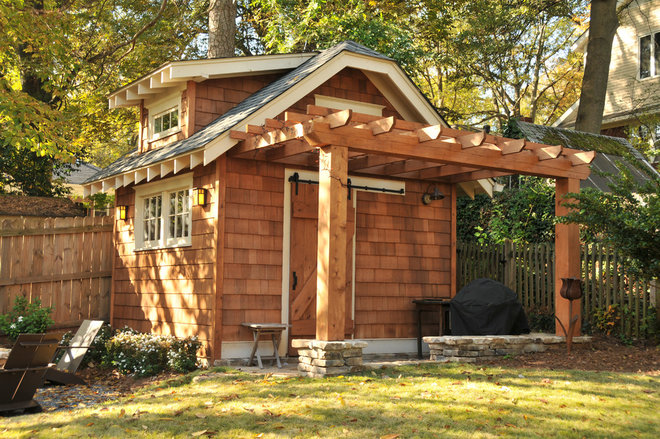 Traditional Garage And Shed by Innovative Construction Inc.