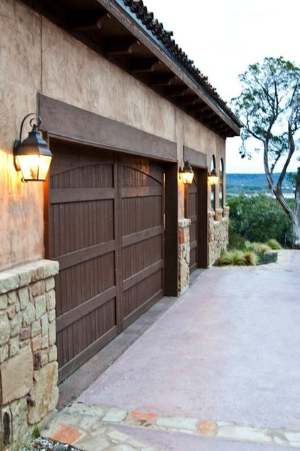 mediterranean garage and shed by JMC Designs llc