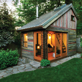 Inspiration for a rustic detached shed remodel in Portland